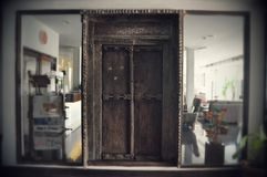 Old wooden Door framed by modern glass Stock Photos