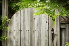 Old wooden door in the garden. Stock Photos