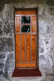 Old wooden door with glass in ancient building Stock Photography