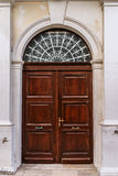 Old wooden door with glass in ancient building Royalty Free Stock Photo