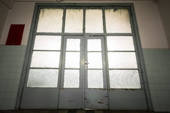 Old wooden door glass, back light Royalty Free Stock Image