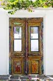 Old wooden door. Old gunged painted wooden door Stock Photos