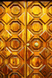 Old wooden door with handel. Old yellow wooden door with handel Royalty Free Stock Photography