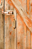 Old wooden door with a handle and an ancient castle Royalty Free Stock Images