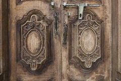 Old wooden door Handle and bolt. Royalty Free Stock Photography