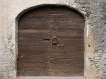 Old Wooden door with handle knocker and lock of medieval house Stock Photos