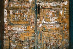 Old wooden door with handle and lock. Many layers of paint in different colors. stock images