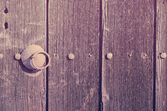 Old wooden door with handle Stock Image