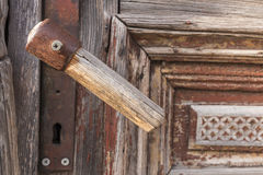 Old wooden door handle. Old red wood doors handle Stock Photography