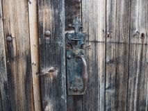 Detail of the old wooden door of a barn, in the French countryside royalty free stock images
