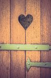 Old wooden door with heart decoration - retro and vintage style Stock Image