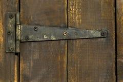 Old wooden door with hinge Stock Photo