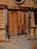 Old wooden door and historic building. Close up of an old wooden door and building, home related Royalty Free Stock Photo