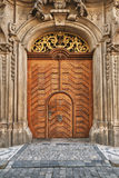 Old wooden door. Wooden door historic building in Prague Stock Images