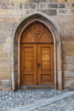 Old wooden door. Historic gate in the town house in Prague Royalty Free Stock Image