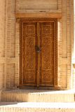 Old Wooden Door with Engravings Stock Images