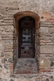 Old wooden door in a brick wall royalty free stock photos