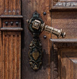 Old wooden door with iron handle. On the Franciscans Church of the Annunciation in Ljubljana, Slovenia stock images
