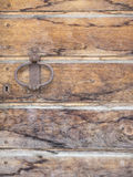 Old wooden door with iron handle and lock Royalty Free Stock Photography