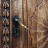 Old wooden door with iron handle. On the Prešeren square in Ljubljana, Slovenia royalty free stock photos