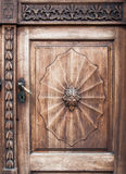 Old wooden door with iron handle royalty free stock images