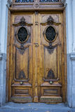 Old wooden door with iron knockers Royalty Free Stock Photo