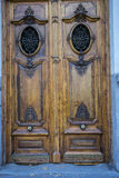 Old wooden door with iron knockers Stock Photos