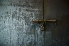 Old wooden door with iron lock Stock Photo
