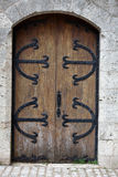 Old wooden door with iron ornaments Royalty Free Stock Image