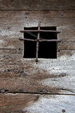 Old Wooden Door. With irone window guard, France Royalty Free Stock Images