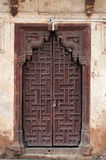 Old wooden door in Jahangir Mahal or Orchha Palace Stock Images