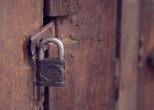Old wooden door with key lock stock photos
