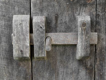 Old wooden door latch. Stock Photos