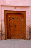 Old wooden door leading to Riad in Medina of Marrakesh Stock Images