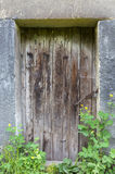 Old wooden door. Leads to basement in church Royalty Free Stock Images