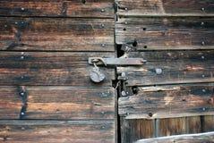 Old wooden door. With lock stock photos
