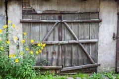 Old wooden door with lock Stock Photos