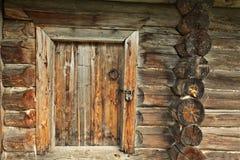 Old wooden door with lock Stock Image