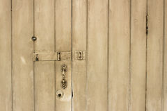 Old wooden door. With door lock, handle, key hole, and eye hole Royalty Free Stock Photography