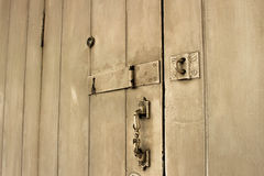 Old wooden door. With door lock, handle, key hole, and eye hole Royalty Free Stock Image