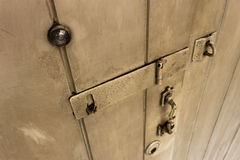 Old wooden door. With door lock, handle, key hole, and eye hole Stock Photos