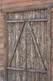 Old wooden door without lock and handle. Old natural wooden door without lock and handle; Exterior element Royalty Free Stock Photos