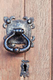 Old wooden door with lock and knob Stock Image
