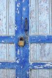 Old wooden door with lock. Old wooden door with metal lock,close look for metal door lock Royalty Free Stock Photography