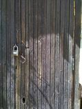 Old wooden door with lock royalty free stock image