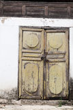 Old wooden door with lock. Old wooden door with white wall Royalty Free Stock Images