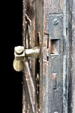 Old wooden door that looks ancient stock photography
