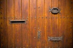 Wooden door with doorknob Stock Images