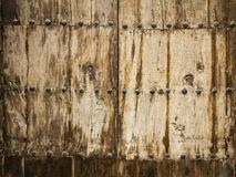 Old wooden door at Mdina, Malta. Old wooden door enforced with rivets at Mdina, Malta Stock Photos