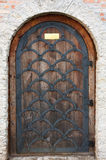 Old wooden door from medieval era. Stock Image